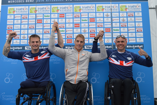 Jetze Plat of the Netherlands (centre) celebrates his paratriathlon gold medal in the PT1 event at the European Championships in Kitzbuhel today ©ETU