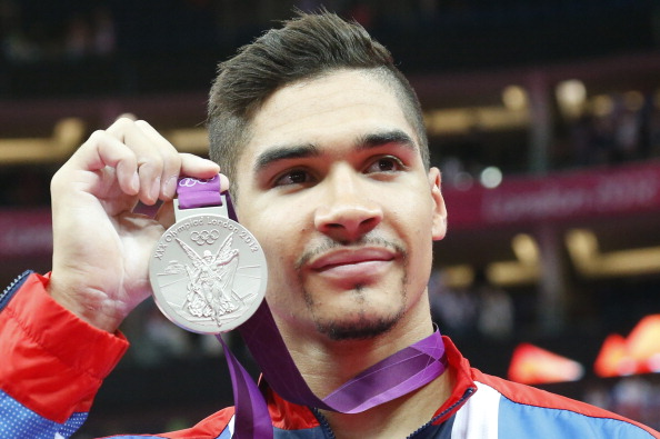 Louis Smith, seen showing off his London 2012 silver in the Pommel Horse, will make his international return at the Glasgow 2014 Games after takiing a year off ©AFP/Getty Images