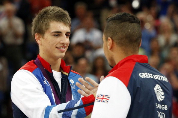 Max Whitlock (left) shakes hands with Britain team-mate Louis Smith after they have taken respective bronze and silver in the pommel horse at the London 2012 Games. Both are named in the England team for next month's Glasgow Commonwealth Games ©AFP/Getty Images