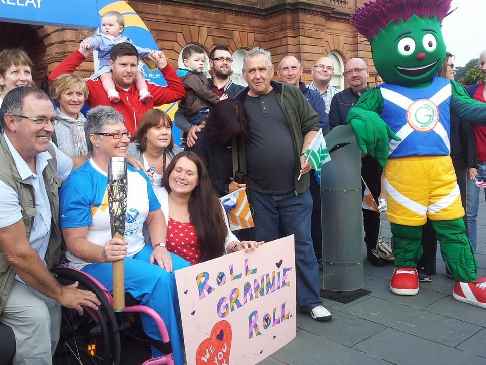 Anne-Marie Monaghan, pictured with enthusiastic friends and family members, as well as Glasgow 2014 mascot Clyde, before carrying the Baton on to the streets of Glasgow ©ITG