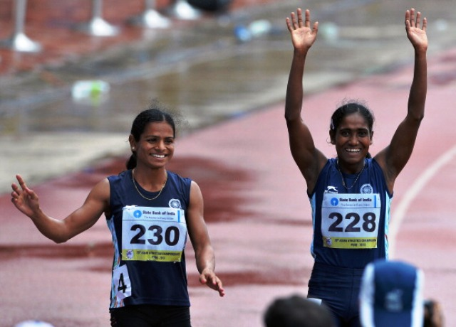 Dutee Chand (left) won 200m bronze at last year's Asian Athletics Championships in Pune ©AFP/Getty Images
