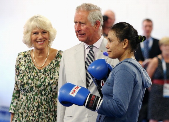 Prince Charles and the Duchess of Cornwall getting some boxing tips