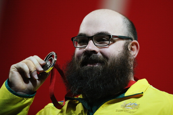 Damon Kelly celebrates weightlifting gold ©Getty Images