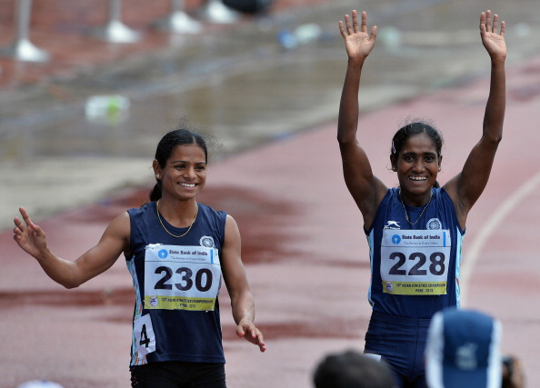 Dutee Chand (left) has become the latest victim of the IOC/IAAF gender policy ©AFP/Getty Images