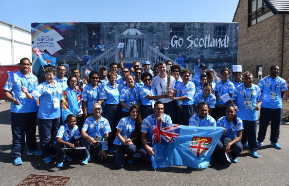 Fijian athletes with the Queen's Baton Relay ©Getty Images