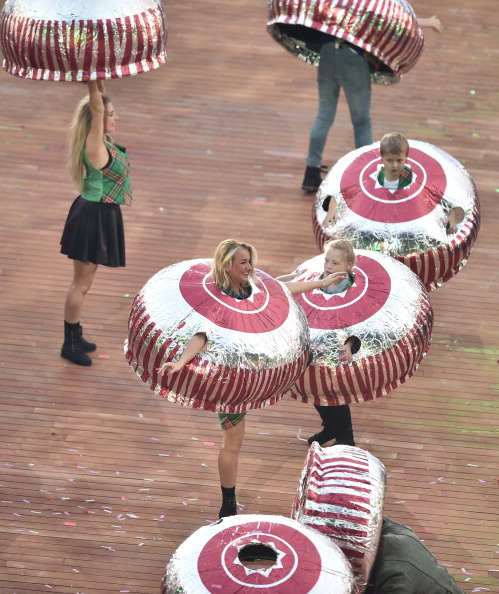 Participants at the Opening Ceremony wear costumes in the shape of Tunnock's Teacakes ©Getty Images