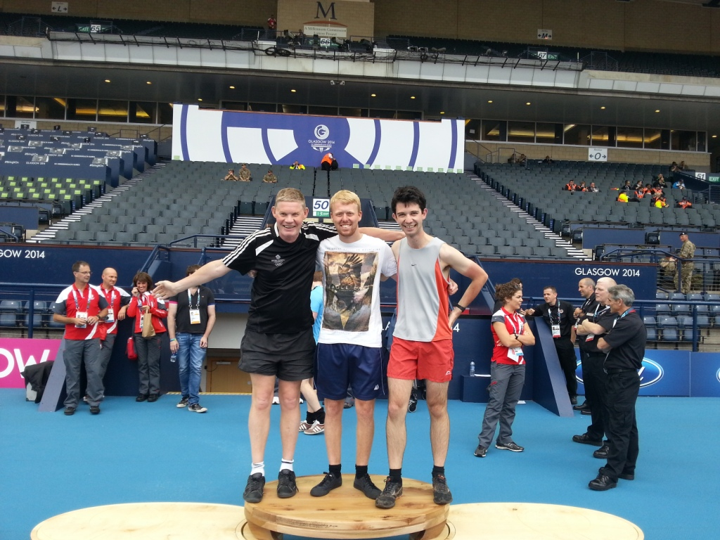 Reporter's Paul Osborne and Nick Butler with Philip Barker on the medal podium at Hampden Park
