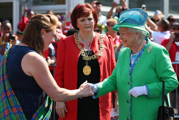 The Queen is greeted by Village chieftain Shirley Addison during her visit to the Athletes Village ©Getty Images
