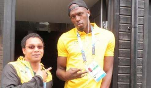 Usain Bolt on Twitter with swimmer Jevon Atkison ©Twitter