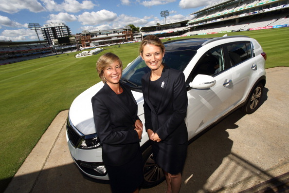 Head of women's cricket Clare Connor (left) and team captain Charlotte Edwards pose with a Kia Sportage at Lord's Cricket Ground ©Getty Images