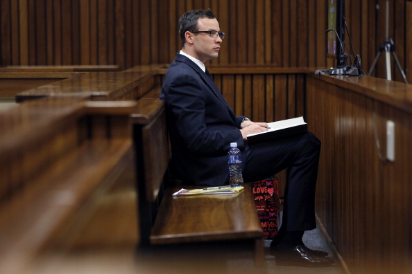 Oscar Pistorius listened to a second day of evidence from sports medicine Professor Wayne Derman ©AFP/Getty Images