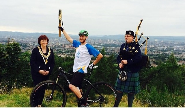 Rob Wardell carrying the Baton on the Cathkin Braes Mountain Bike trails this morning ©Rob Wardell/Facebook