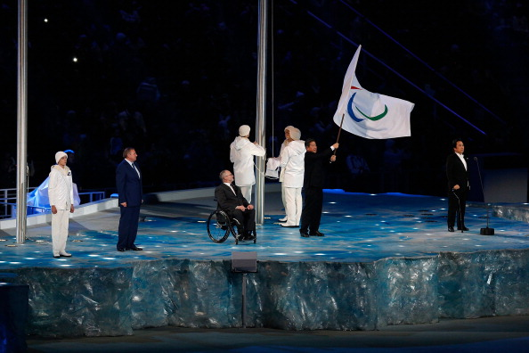Sir Philip oversees the handing over of the Paralympic Flag to the Mayor of Pyeongchang during the Closing Ceremony of Sochi 2014 ©Getty Images