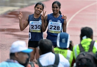 Sprinter Dutee Chand (left) has been embroiled in a gender row after being left out of the Indian athletics squad for Glasgow 2014 ©AFP/Getty Images
