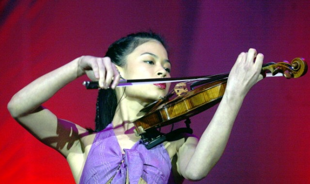 Vanessa Mae shot to fame as a talented musician earning her worldwide acclaim ©AFP/Getty Images