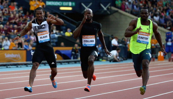 Yohan Blake (left) staggers to a halt in the 100m at Glasgow's Diamond League meeting ©Getty Images