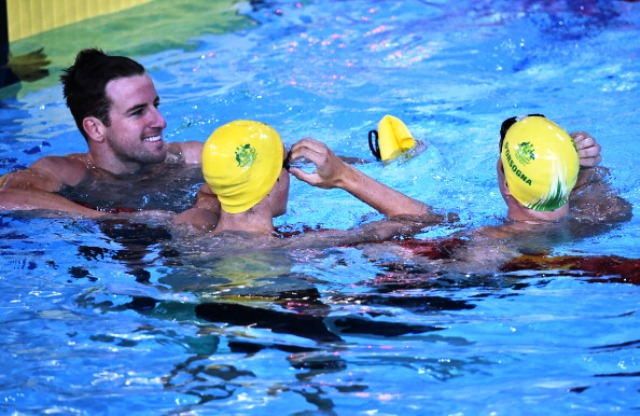 James Magnussen is already getting his digs in on team mates Cameron McEvoy (centre) and Tommaso D'Orsogna (right) after taking the 100m freestyle win ©AFP/Getty Images