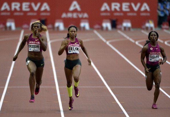 Blessing Okagbare (left) en route for 200m victory in Paris ahead of Olympic champion Allyson Felix (centre) and World champion Shelly-Anne Fraser-Pryce ©AFP/Getty Images