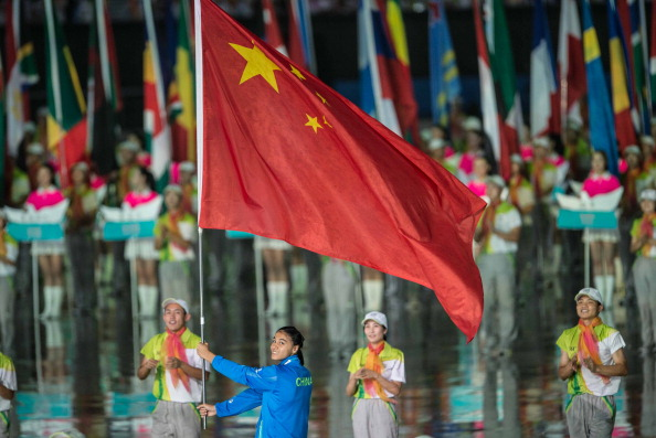 Dilixiati Dilana led the Chinese team into the stadium to huge cheers from the watching crowd ©ChinaFotoPress via Getty Images