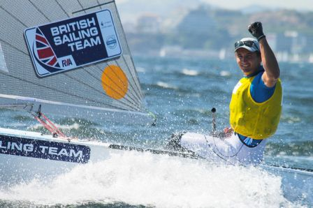 Giles Scott celebrates his dominant victory in the finn class during the Test Event in Rio ©ISAF