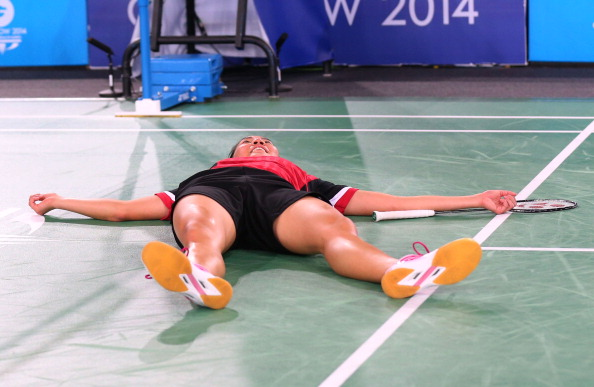 Michelle Li collapses to the ground after winning the gold medal ©Getty Images