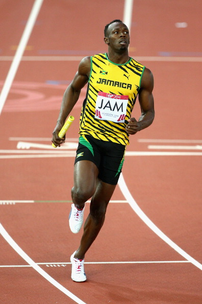 Usain Bolt crosses the line to lead Jamaica to victory in their relay heat ©Getty Images