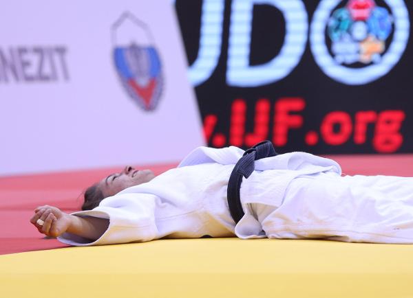 Majlinda Kelmendi slumps to the tatami after retaining her under-52kg World Championships title ©IJF