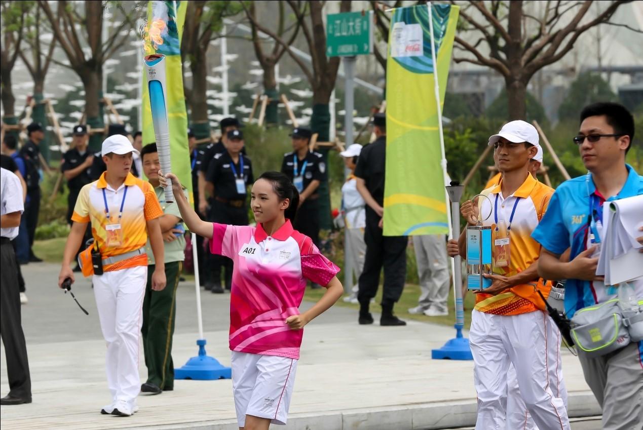 Nanjing University student and Youth Olympic volunteer, Liu Yige, was the first Torchbearer ©Nanjing 2014