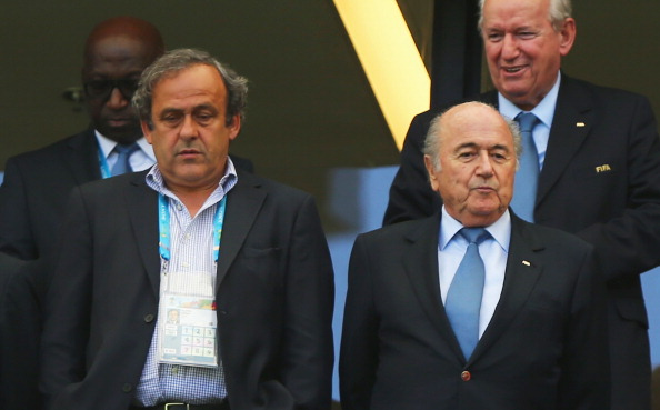 Michel Platini (left) has been highly critical of Sepp Blatter (right), but has chosen not to run against his for the FIFA Presidency ©Getty Images