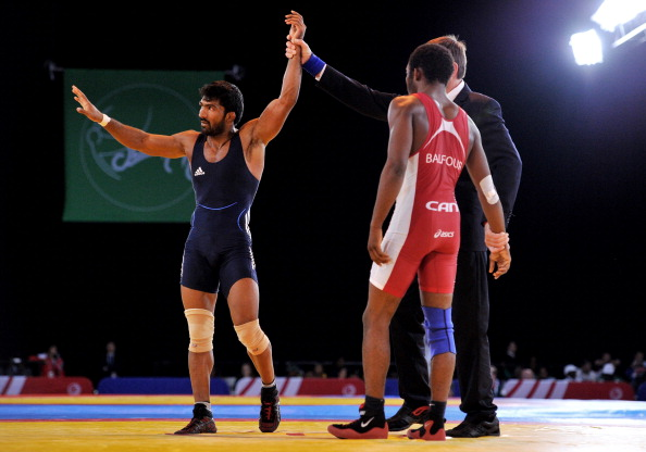 Yogeshwar Dutt of India celebrates a fifth gold for India ©AFP/Getty Images