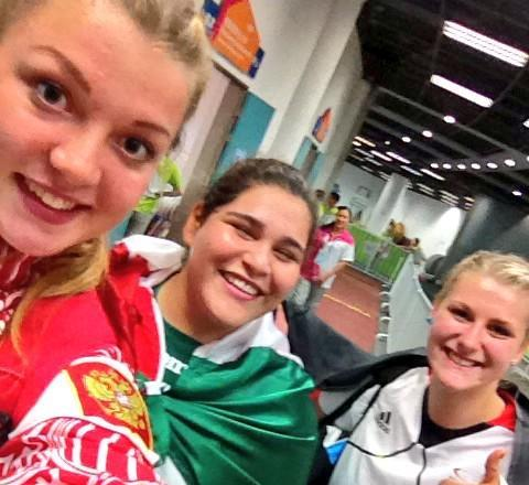 All's fair in love and war... The three women's shot put medallists share a selfie ©Twitter
