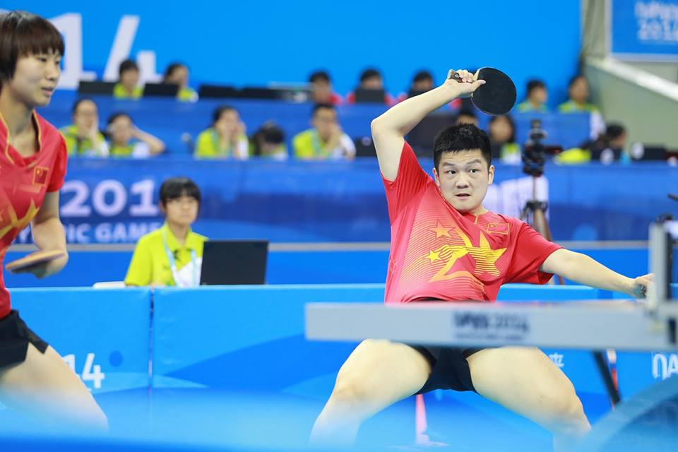 Fan Zhendong in mixed doubles table tennis action ©ITTF