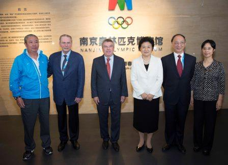 Jacques Rogge (second left) and Yu Zaiqing (left) were others in attendance at the opening today ©IOC/Ian Jones