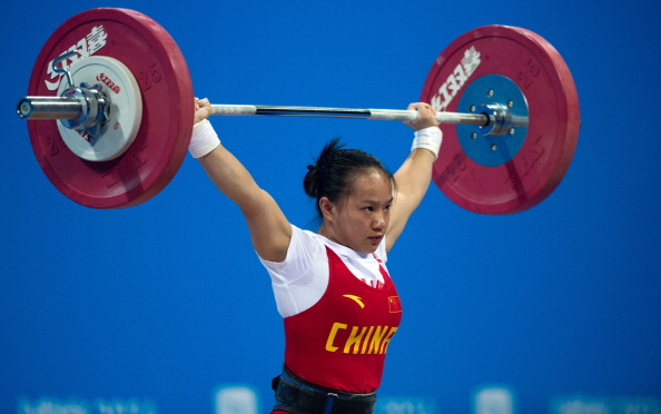 Jiang Huihua put in a fine display to win China's first gold medal of Najing 2014 in the women's 48kg weightlifting competition ©Getty Images