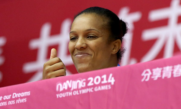 Lucie Decosse fulfiling her role as the Athlete Role Model for judo at Nanjing 2014 ©IJF