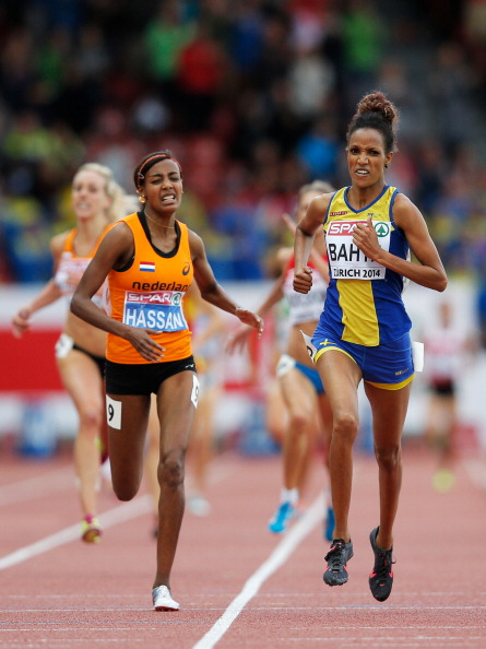 Sweden's Meraf Bahta celebrates as she crosses the finish next to Sifan Hassan of The Netherlands to win gold in the 5,000 metres ©Getty Images