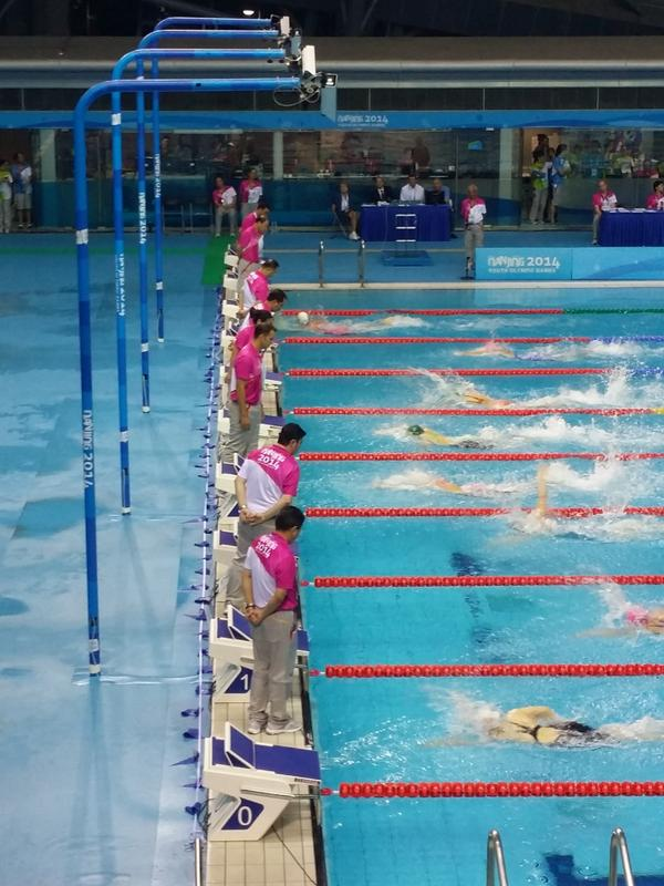Officials gettting a good look at Chinese domination in the swimming ©Twitter