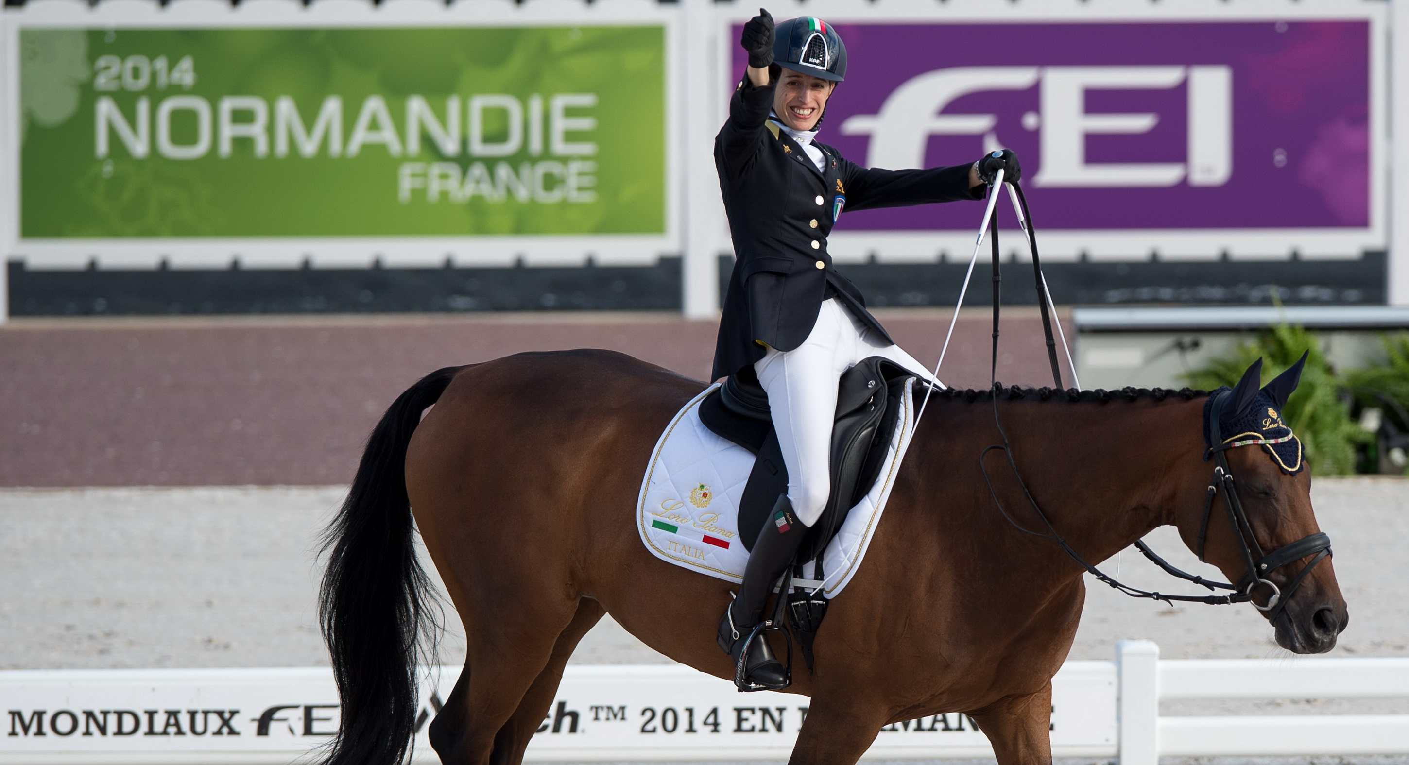 Sara Morganti with Royal Delight scored a thrilling top spot at today's Round 1 Grade Ia team competition at the World Equestrian Games ©FEI