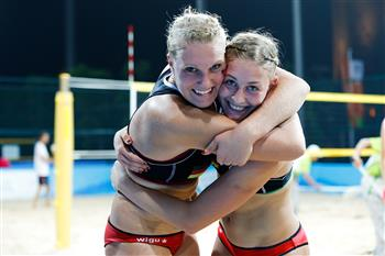 Sarah Schneider and Lisa Arnholdt of Germany celebrate victory ©FIVB