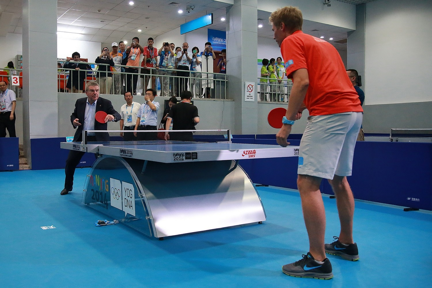 Thomas Bach practices some table tennis with Swedish great Jorgen Persson ©ITTF