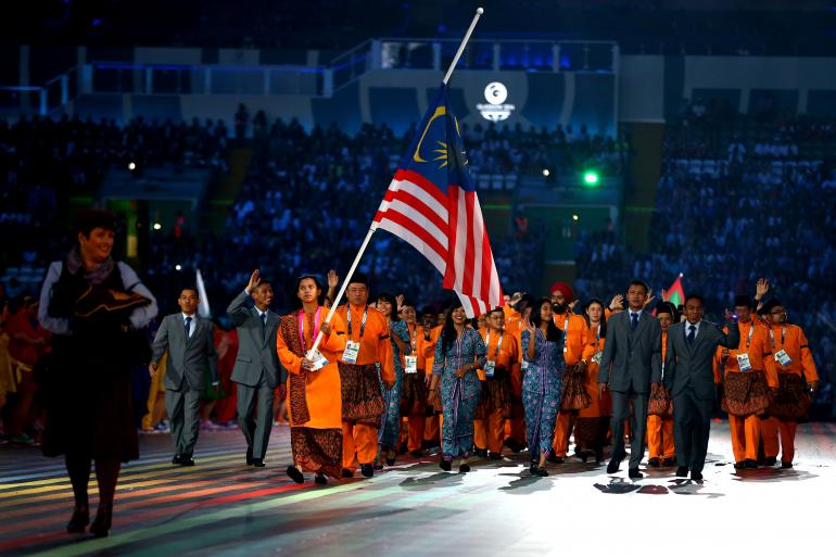 Malaysia's team at the Opening Ceremony of Glasgow 2014 had walked in behind a flag that was at half-mast as they all wore black armbands in memory of those killed when flight MH17 crashed ©AFP/Getty Images