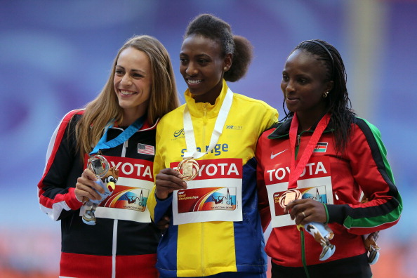 Jennifer Simpson (left) shows her silver medal after last year's 1500m final at the World Championships in Moscow, alongside champion Abeba Aregawi and (right) bronze medallist Hellen Obiri of Kenya ©Getty Images