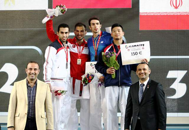 Ali Sofuoğlu raises his arm in triumph after delighting the home fans with victory in the men's kata category ©WKF