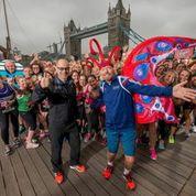 Hugh Brasher (left), Virgin Money London Marathon race director and Sir Richard Branson (right), Virgin founder celebrating the success on the London Tower Bridge ©Bob Martin for Virgin Money London Marathon