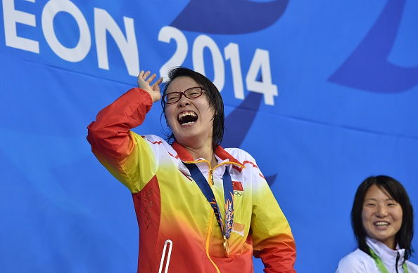 A delighted Fu Yuanhu celebrates 50m backstroke gold AFP/Getty Images