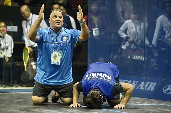Abdullah Almezayen celebrates his remarkable squash singles title ©AFP/Getty Images
