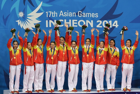 China celebrate gold in synchronised swimming ©AFP/Getty Images