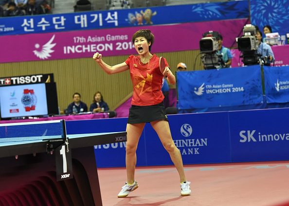 Ding Ning celebrates as she makes amends for her earlier loss and earns China team gold ©AFP/Getty Images