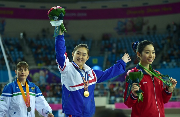 Hong Un-Jong celebrates after her gold medal on the vault ©AFP/Getty Images