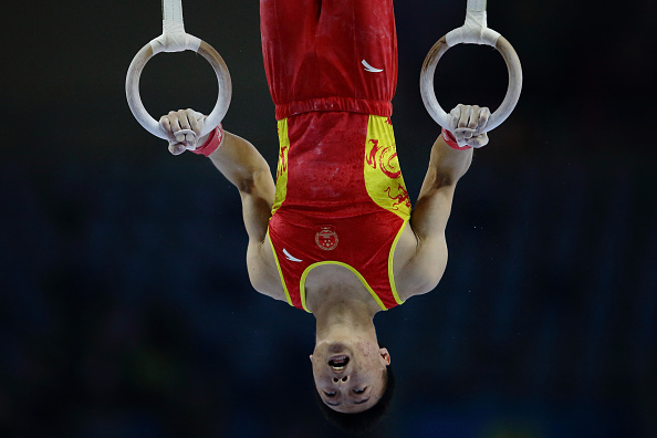 Huang Xi of China competing in the rings in the team gymnastics competition ©Getty Images